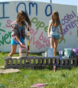 Deb Eck's twin daughters painting barricades, Occupation of Riverdale, June 2012