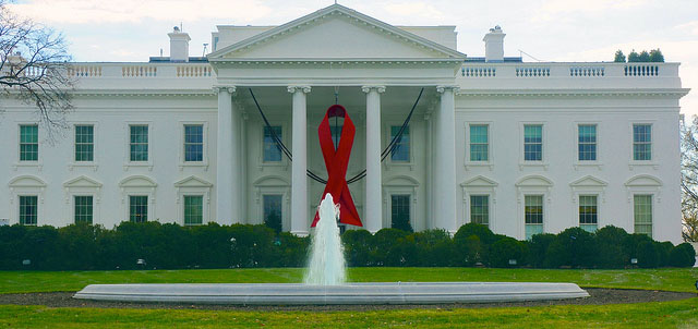 """World AIDS Day - Red Ribbon on the White House Portico.""  Photo Credit: Ted Eytan, Flickr"