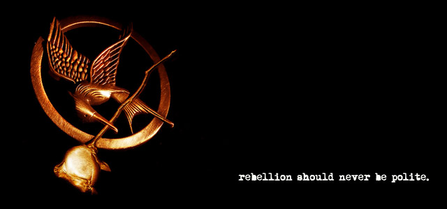 "Mockingjay pin credit: Tao Zero, ""The New Order."" Flickr."
