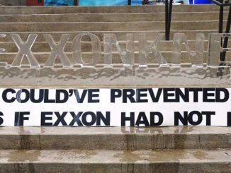 Main image: ExxonMobil shareholders were greeted with a message at their May 2016 AGM. Credit: Flickr/350.org